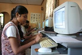 A school student in Sri Lanka practises the computer skills taught to her on our volunteer Teach IT project.